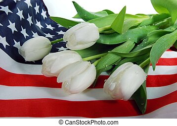 We Remember - Wet tulips on a flag.