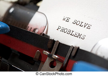 We solve problems phrase written with a typewriter.