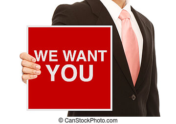 We Want You - A businessman holding a recruitment signboard...