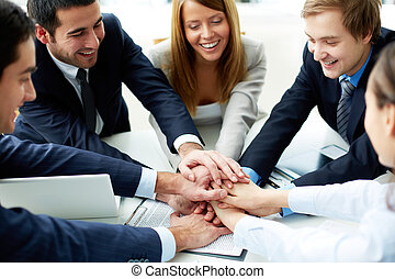 We will win - Image of business partners making pile of...