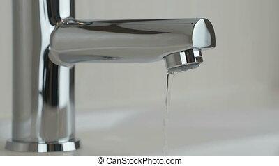 Weak water pressure flowing from a chrome tap - The weak...