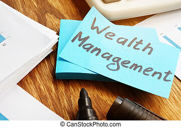 Wealth management. Business report, calculator and marker.