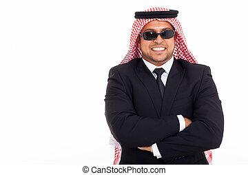 wealthy arabian businessman wearing shades over white...
