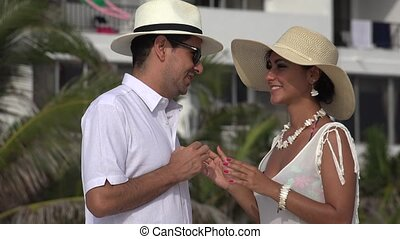 Wealthy Married Couple Talking On Vacation