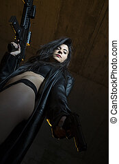 Weapon, Army brunette girl with gun in a garage in attitude shoot, dressed in bulletproof vest