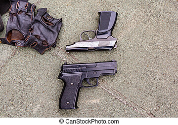 Weapons on the ground. Rifles pistols guns body armor