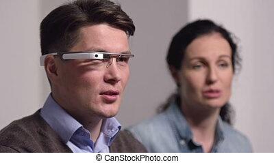 Wearable Computing - Focus on man wearing google goggles...