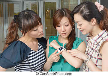 wearable watch - Asian woman using wearable watch and...