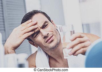 Wearied man having migraine