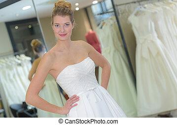 wearing a designer wedding gown