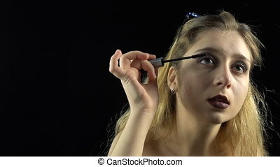 Wearing mascara young girl - Footage of blond woman with...