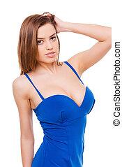 Wearing my favorite dress. Beautiful young woman in...