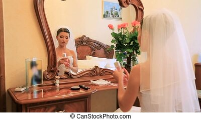 Wearing Perfume - Bride applying her perfume before the...