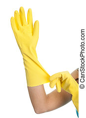 Wearing protective gloves - Close-up on female hands wearing...