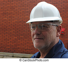 Wearing safety glasses & hard hat