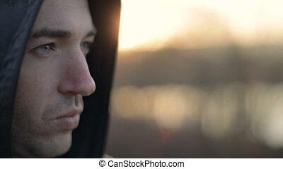 Wearing The Hood - Handsome caucasian man is wearing hood,...