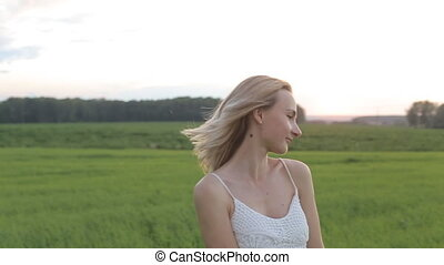 wearing white dress standing in a field