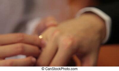 wears a wedding ring