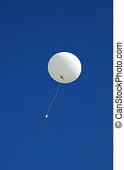 Weather balloon ascending - A white weather balloon is...