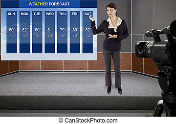 Weather Forecaster - young woman on stage with weather chart...