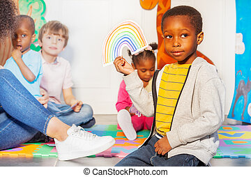 Weather game in the nursery class and boy portrait
