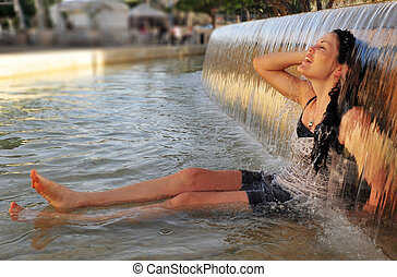Weather photos - Heat wave - Woman enjoy the cold waters of...