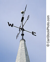 Weather Vane Atop Steeple - A black metal weather vane...