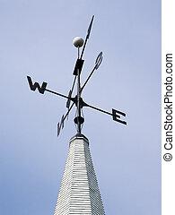 Weather Vane Atop Steeple - A black metal weather vane...