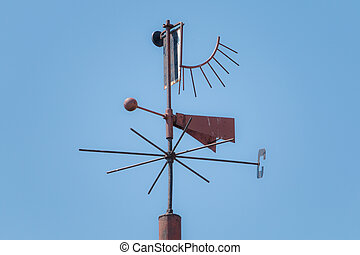 Olr rusty weather vane shows direction to west in Lithuania