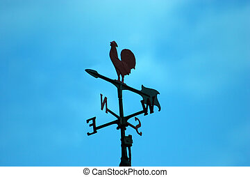 Weather Vane Silhouette against the remains of a blue sky just before sunset