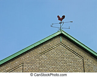 Weathercock vane on a roof