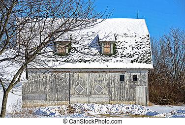 weathered barn in winter