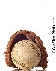 weathered baseball and baseball glove
