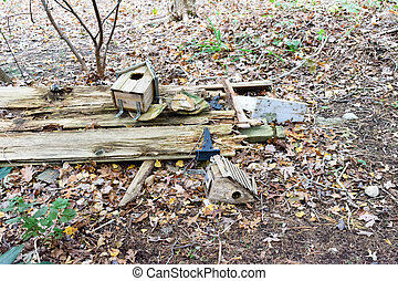 Weathered Birdhouses and Pottery