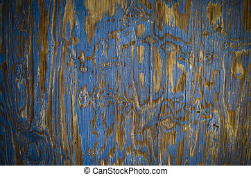 weathered blue paint on wood grain