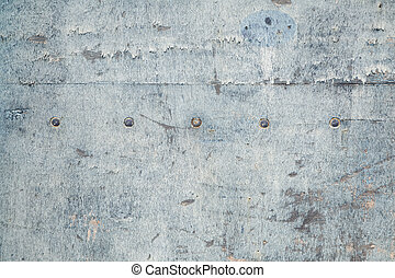 weathered board with old blue paint and bolts