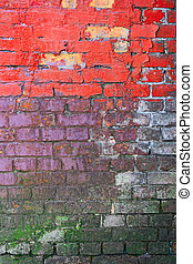 Weathered brick wall painted in three different colors