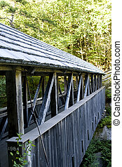 Weathered covered bridge in New England