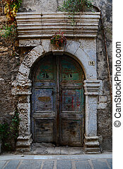 Weathered door on the old town of Chania, Crete island