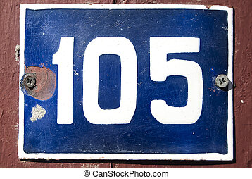 Weathered grunge square metal enameled plate of number of street address with number 105