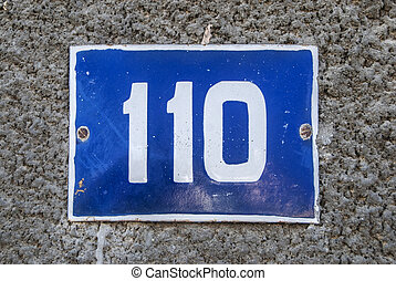 Weathered enameled plate number 110