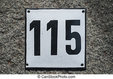 Weathered enameled plate number 115