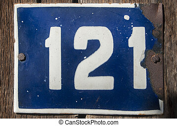 Weathered enameled plate number 121