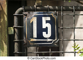 Weathered enameled plate number 15