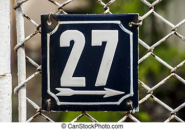 Weathered enameled plate number 27