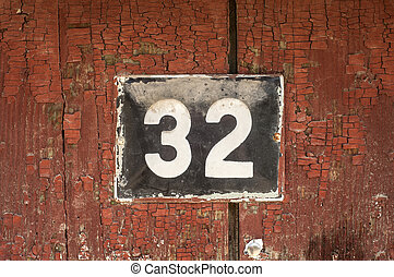 Weathered enameled plate number 32