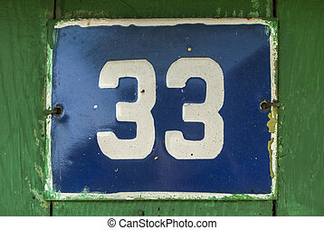 Weathered enameled plate number 33