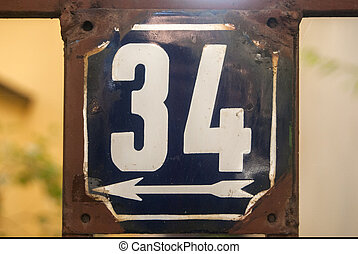 Weathered enameled plate number 34