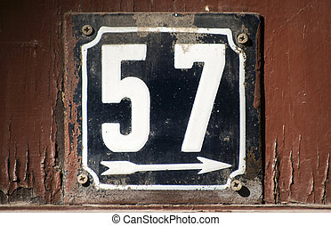 Weathered enameled plate number 57