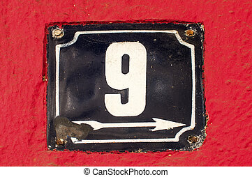 Weathered enameled plate number 9